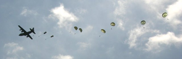 Part of a mass parachute drop near St Mere Eglise, 60th anniversary of D Day, June 2004