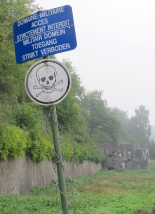 Bloc 6 bunker and sign in mist at fortress Eben-Emael. (C) Aurora Publishing.