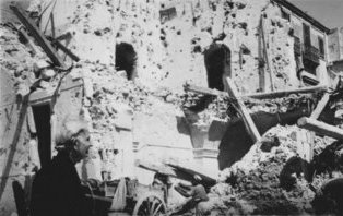 Tullio Marcon story - old lady by bombed house in Sicily