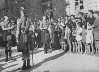 Tullio Marcon story - Scots soldiers play the bagpipes for Italians during Operation Husky, the Allied invasion of Sicily