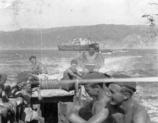 "Original caption: ""Bathing party at Suez"". SRS men in LCAs head off on a swimming expedition, with their troopship, the Ulster Monarch, in the background. Source: Davis"
