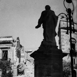 St Peter silhouette looks on ruins in cathedral square caused during bombing of Syracuse